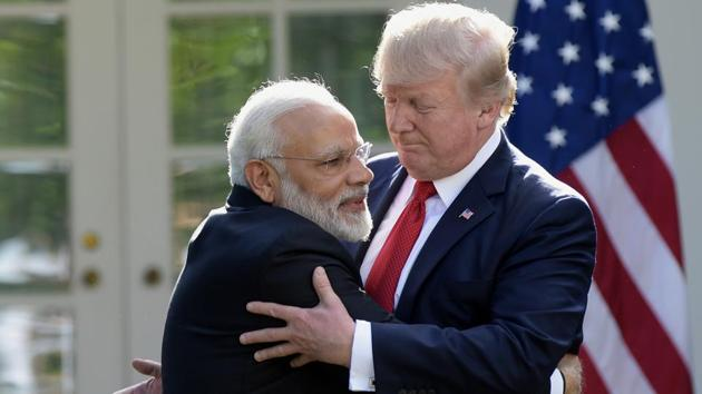 Prime Minister Narendra Modi and US President Donald Trump hug while making statements in the Rose Garden of the White House in Washington.(AP Photo)