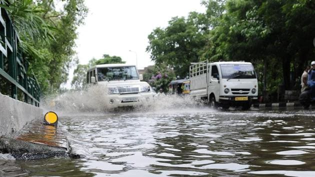 The road dividing Sector 6970 was inundated after heavy showers last week(HT Photo)