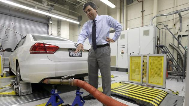 In this Sept 30, 2015, file photo, a 2013 Volkswagen Passat with a diesel engine is evaluated at the emissions test lab in El Monte, Calif. Real world pollution from diesel trucks, buses and cars globally is more than 50% higher than what government lab testing says it should be. And that translates to an extra 38,000 deaths worldwide from soot and smog, a new study say.