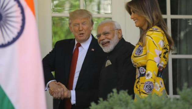 US President Donald Trump (L) and first lady Melania Trump welcome Indian Prime Minister Narendra Modi to the White House in Washington.(Reuters)