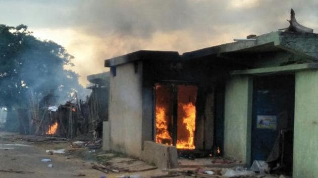 When police reached the village, the crowd had surrounded the house. The mob clashed the police team and set the house on fire.(HT Photo)