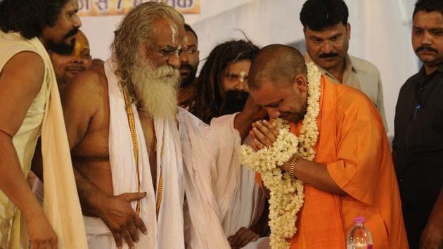 Chief minister of Uttar Pradesh Yogi Adityanath attending the birthday celebrations of Nritya Gopal Das in Ayodhya on Wednesday.(Deepak Gupta/Hindustan Times)