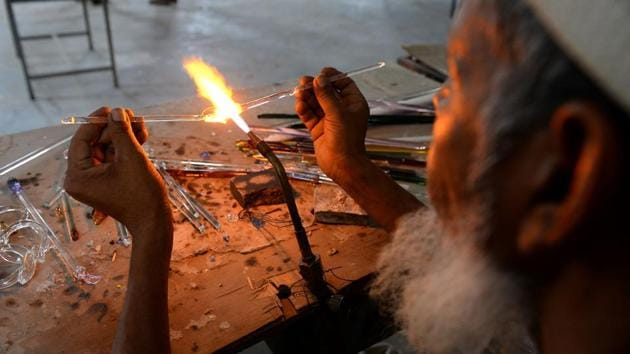 <p>In the blazing-hot workshops dotting the district of Firozabad, the Taj Mahal is a sore subject for craftsmen toiling over thousand-degree furnaces to...