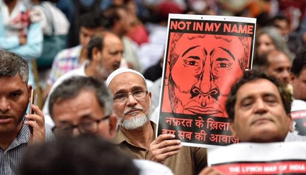 <p>Protesters  hold  placards in support of the campaign, &lsquo;Not In My Name&rsquo;, at Jantar Mantar  in New Delhi. Facebook post by a filmmaker against the...