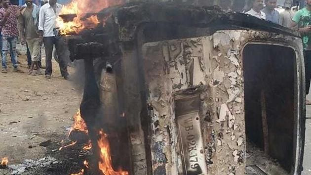 Pictures circulating on social media showed people hitting the man, meat pieces strewn on the road, and his car in flames.(HT)