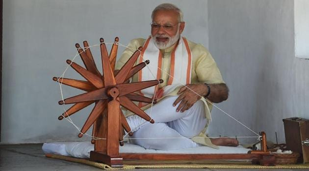 Prime Minister Narendra Modi spins a yarn on a charkha (spinning wheel) during his visit to Mahatma Gandhi's Sabarmati Ashram in Ahmedabad on Thursday.(AFP)