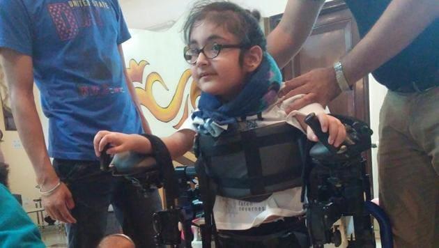 Maggu's nephew Praneit, nine, trying out the exoskeleton in Delhi.(Courtesy Trexo Robotics)