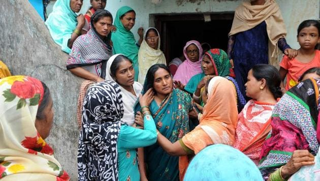 """""""Mob justice would be meted with mob-justice,"""" said Mariam Khatun (centre in green), the wife of the dead trader, as scores of people flooded her modest home to console her.(Parwaz Khan/ Hindustan Times)"""