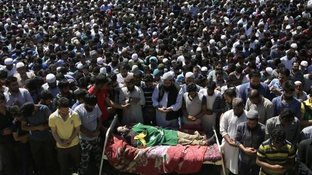 Kashmiri villagers offer funeral prayers near the body of Bashir Lashkari,during his funeral in his native village of Souf, south of Srinagar, on July 2, 2017(AP)