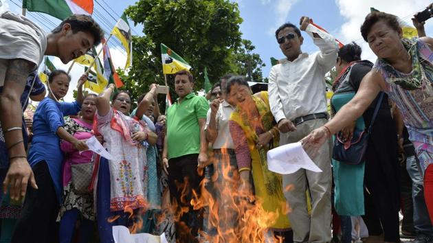 File photo of Gorkha Janmukti Morcha (GJM) supporters burning copies of the Gorkhaland Territorial Administration (GTA) in Darjeeling. The success of the Gorkhaland agitation could boost demands for eight separate states in northeast India.(AFP)