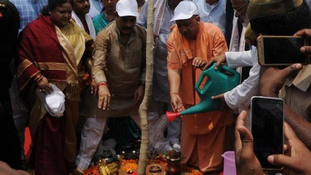 UP chief minister Yogi Adityanath planting a sapling in Nakshatra Vatika at Kukrail picnic spot in Lucknow, on Saturday.(Subhankar Chakraborty/HT Photo)