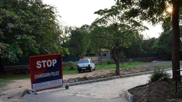 The minister has encroached upon a green belt by constructing a road using interlocking tiles outside his house in Sector 2, Chandigarh.(HT Photo)