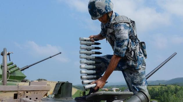 File photo of a Chinese soldier loading ammunitions into a ZBD-03 armoured infantry vehicle before live fire training at a military base in central China's Hubei Province on July 2, 2017.(Courtesy China Military Online)