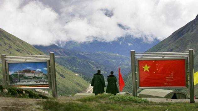 Chinese army officers on the Chinese side of the international border at Nathula Pass in Sikkim. (AP Photo/Gurinder Osan)(AP)