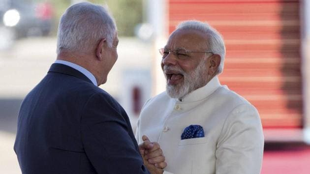 Prime Minister Narendra Modi and Israeli Prime Minister Benjamin Netanyahu shake hands during welcome ceremony upon arrival in Ben Gurion airport near Tel Aviv Tuesday.(AP Photo)