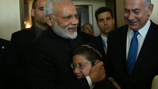 Prime Minister Narendra Modi with 2008 Mumbai terror attacks survivor Moshe Holtzberg.(Twitter/@MEAIndia)