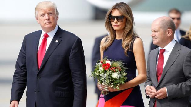 U.S. president Donald Trump and first lady Melania Trump arrive for the G20 leaders summit, having made a stopover in Poland before heading for Germany. (Axel Schmidt / Reuters)