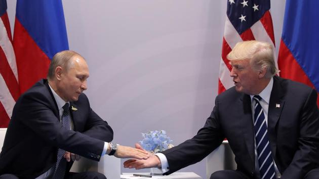 US President Donald Trump greets Russian President Vladimir Putin during the their bilateral meeting at the G20 summit in Hamburg, Germany.(REUTERS)