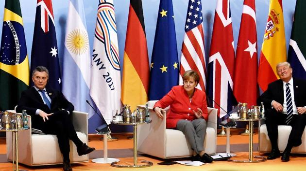 Argentinia's President Mauricio Macri, German chancellor Angela Merkel and US President Donald Trump at the start of the retreat meeting on the first day of the G20 summit in Hamburg, Germany.(Reuters Photo)