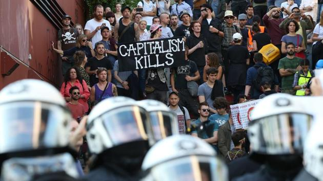 Police officers in operation during a protest against the upcoming G20 summit in Hamburg, Germany, Thursday July 6, 2017. Protestors took to placards, marches and were met with riot police in response to these gatherings. (Bodo Marks / AP)