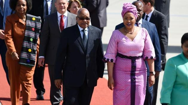 South Africa's President Jacob Zuma and his wife arrive at the airport in Hamburg as leaders of the world's top economies gather from July 7 to 8, 2017 in Germany for likely the stormiest G20 summit in years. (Patrik Stollarz / AFP)