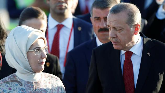 Turkey's President Recep Tayyip Erdogan and his wife Emine arrive for the G20 leaders summit in Hamburg, Germany. (Axel Schmidt / Reuters)