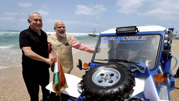Prime Minister Narendra Modi with his Israeli counterpart Benjamin Netanyahu during a visit to the Olga Beach in Israel, July 6, 2017(PTI)