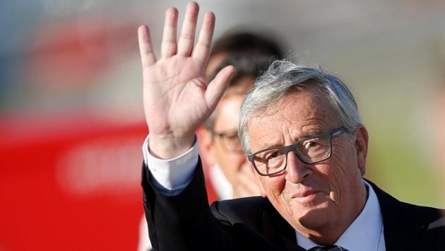 President of the EU Commission Jean-Claude Juncker waves as he arrives for the 2017 G20 leaders summit. (Axel Schmidt / Reuters)
