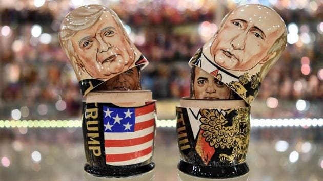 Traditional Russian Matryoshka dolls, depicting US President Donald Trump (L) and Russia's President Vladimir Putin (R) at a gift shop in central Moscow. Trump is due to meet his Russian counterpart Vladimir Putin for the first time since becoming president, during the G20 summit in Germany. (Kirill Kudryavtsev / AFP)