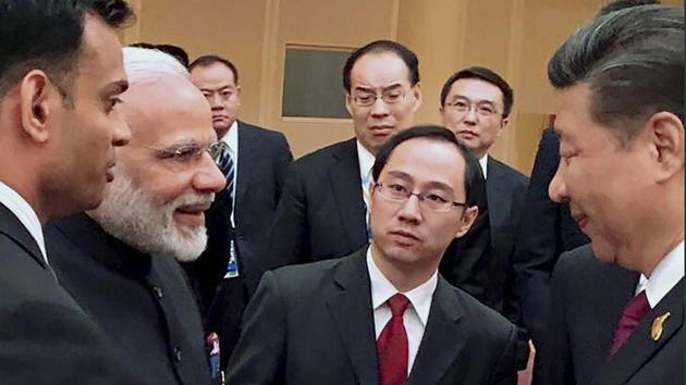 Prime Minister Narendra Modi and Chinese President Xi Jinping exchange greetings at the BRICS leaders' informal gathering at G2 in Hamburg, Germany on Friday.(PTI Photo)