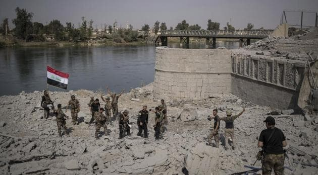 Iraqi Special Forces soldiers celebrate after reaching the bank of the Tigris river as their fight against Islamic State militants continues in parts of the Old City of Mosul, Iraq on July 9.(AP Photo)