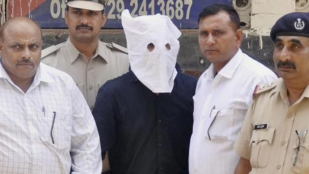 The main accused in Junaid Khan lynching case, before being produced in district court Faridabad on Sunday.(PTI Photo)