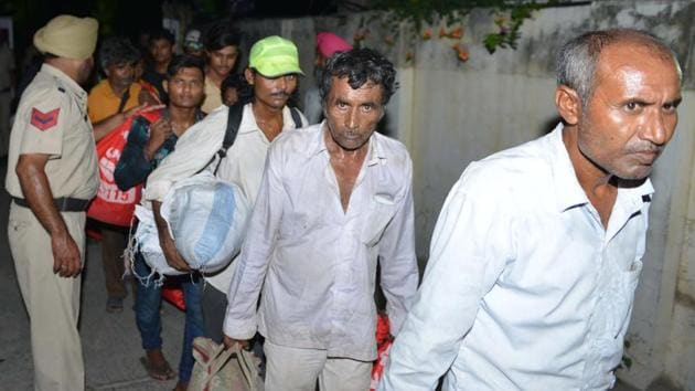 Indian fishermen arrive at a Red Cross House after being released by Pakistani authorities, in Amritsar on July 10.(AFP Photo)