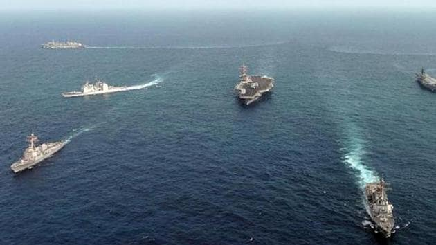 Vessels of the Indian Navy and US Navy in the Indian Ocean during a Malabar naval exercise. The geopolitical subtext of the Malabar exercise is complex and multi-layered (File Photo)(AFP)