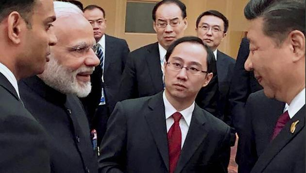 Prime Minister Narendra Modi and President Xi Jinping exchange greetings at an informal gathering of the BRICS leaders in Hamburg, Germany.(PTI)