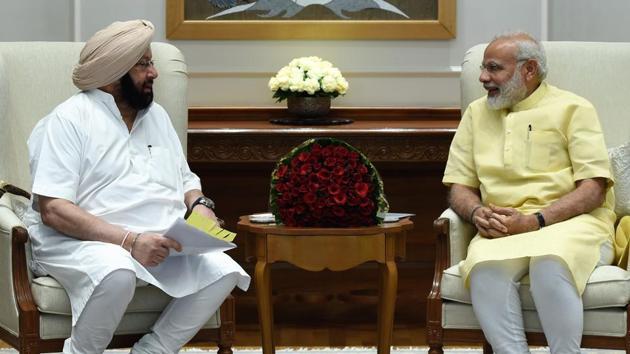 (left) Captain Amarinder Singh and Prime Minister Narendra Modi.(HT File Photo)
