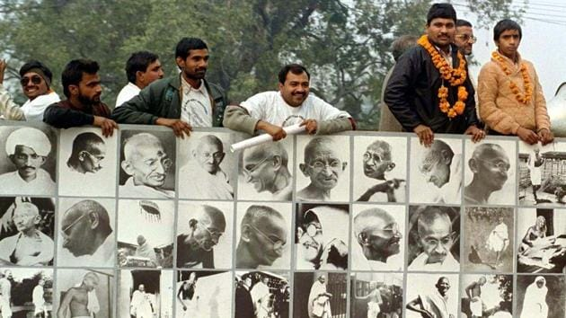 An installation of photographs of the Mahatma during a rally to mark the 50th anniversary of his death, New Delhi, January 30, 1998(Reuters)