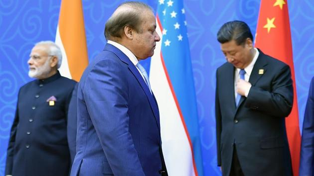 Pakistani PM Nawaz Sharif walks past Prime Minister Narendra Modi and Chinese President Xi Jinping.(AFP File Photo)
