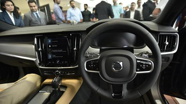The cockpit of the V90 with a stylish steering wheel and auto box. (Burhaan Kinu/HT PHOTO)