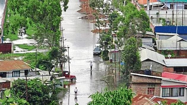 The incessant rainfall has led to flooding along the route leading to National of Technology in Imphal.(HT Photo)
