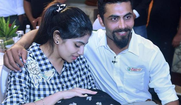 Ravindra Jadeja with wife Reeva Solanki and their new born baby during an event in Mumbai on Wednesday.(PTI)