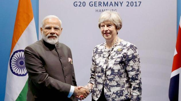 Prime Minister Narendra Modi with Britain's Prime Minister Theresa May on the sidelines of the G20 Summit in Hamburg.(PTI)