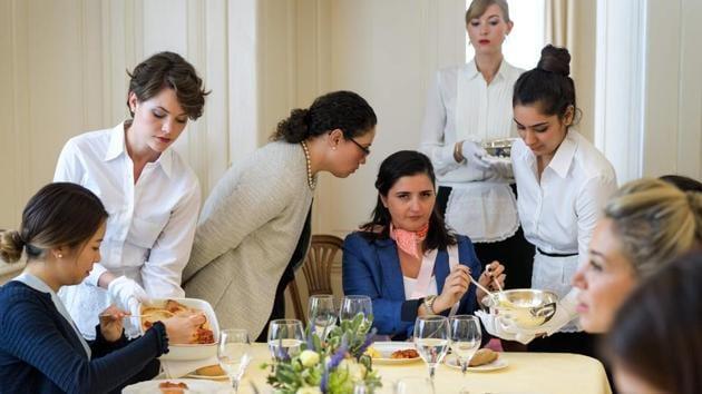 Women attend a lesson at Switzerland's last finishing school, Institut Villa Pierrefeu, in Glion.(Fabrice Coffrini/AFP)