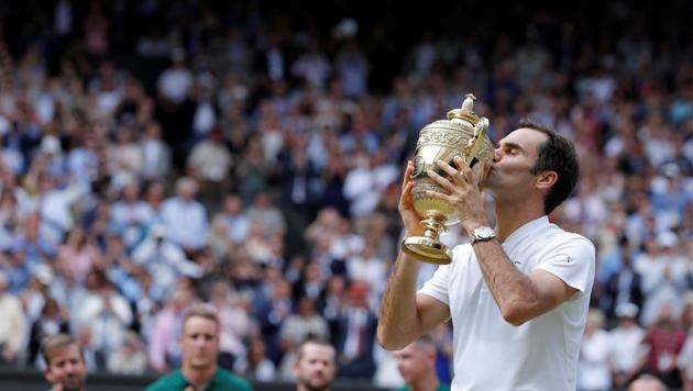 Roger Federer celebrates with the trophy after winning the final against Marin Cilic. Get highlights of Roger Federer vs Marin Cilic here(REUTERS)