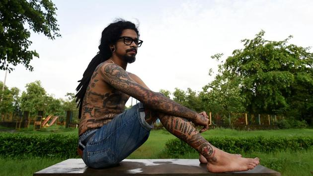 Mumbai resident and tattoo artist Jason George attempted to create a record for the most number of tattoos — 421. He was visited by officials from the Limca book of records on World Tattoo Day. (Bachchan Kumar /HT PHOTO)
