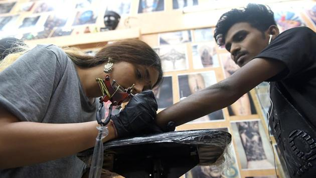 A man gets inked at 21 Tattoo Studio in Vashi on Wolrd Tattoo day. (Bachchan Kumar /HT PHOTO)