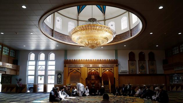 Muslim men pray for victims of the attack at Manchester Arena at a mosque in Manchester, Britain, May 23, 2017.(Reuters)