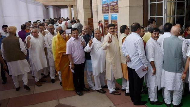Members wait to cast their votes for the election of the President at Parliament in New Delhi on Monday.(PTI)