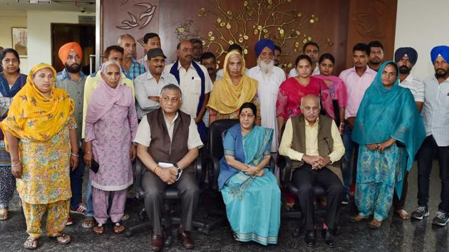 External affairs minister Sushma Swaraj with family members of 39 Indian men, who went missing after being abducted by Islamic State terrorists in Iraq in New Delhi on Sunday. Union ministers VK Singh and MJ Akbar are also seen.(PTI)