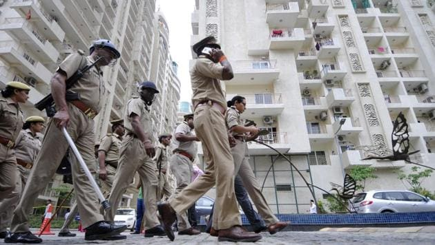 Noida, India - July 12, 2017: Police deployed at Mahagun at sector 78 after locals attacked the housing colony alleging mistreatment of a housemaid, in Noida, India, on Wednesday, July 12, 2017. (Photo by Sunil Ghosh / Hindustan Times)